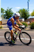 1st Lt. John Bierman, 2nd Space Warning Squadron Delta Crew deputy flight commander, rides a bike in a 2014 triathlon in Tempe, Ariz. Bierman competed for four years on the United States Air Force Academy triathlon team and will compete for the third time on the U.S. Air Force triathlon team June 15-19 in Ventura County, Calif. Courtesy photo by Vivien Cook