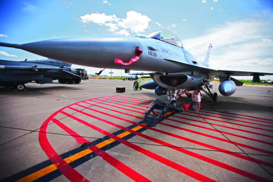 Master Sgt. Ricky Kissell, a crew chief for the 140th Wing of the Colorado Air National Gaurd, gives his F-16 a bath at Buckley Air Force Base. The Air Force's F-16s are soon to be replaced by the new F-35 fighter jet.  (Marla R. Keown/Aurora Sentinel)