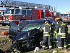 Aurora fire crews work the scene of a two-vehicle head-on collision Saturday morning, April 2, 2016, along East Sixth Avenue near Tower Road in Aurora. (Photo courtesy of Sentinel news partner Denver's 7/TheDenverChannel.com)