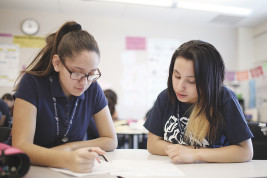 Eight graders, Dayanuri Renteria Menchaca and Sonia Dela Cruz work on their math assignment in Kelly Hutchings' math class on Wednesday March 09, 2016 at Boston K-12. Photo by Gabriel Christus/Aurora Sentinel