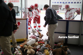 Regis Jesuit team managers and players remove stuffed animals from the ice at Family Sports Center on Dec. 11, 2015, after the Raiders' annual Teddy Bear Toss. (Photo by Gabriel Christus/Aurora Sentinel)