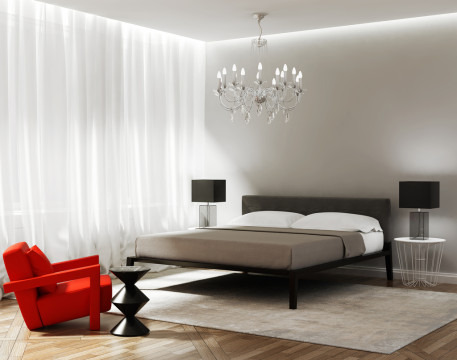 Modern grey bedroom with a red armchair