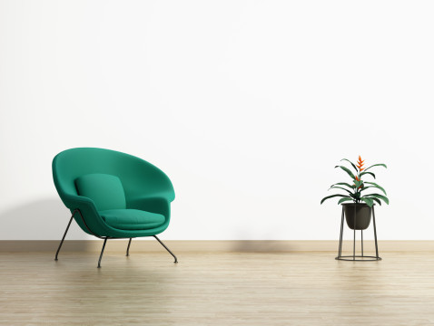 Minimal empty room with a green armchair and a planter