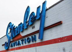 A weathered sign marks its territory Sept. 22 at Stanley Aviation. Built in 1954, Stanley Aviation manufactured airplane ejector seats but after years of being abandoned the building will be getting a facelift. The 100,000 square footage will be transformed into a marketplace that will house a restaurant, beer garden, community park, office spaces and a variety of dining, shopping and recreational options. (Marla R. Keown/Aurora Sentinel)