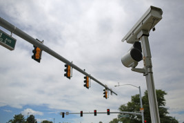 A photo red-light camera is seen at the intersection of East Iliff Avenue and South Chambers Street. Photo by Gabriel Christus/Aurora Sentinel