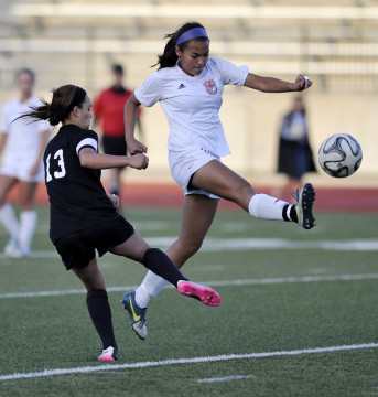Smoky Hill junior-to-be Brittney Lewis (top) during the 2015 girls soccer season. (Photo by Courtney Oakes/Aurora Sentinel)