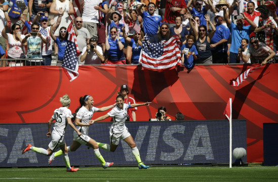 From left, United States' Megan Rapinoe, Lauren Holiday, and Carli Lloyd celebrate after Lloyd scored her second goal of the match against Japan during the first half of the FIFA Women's World Cup soccer championship in Vancouver, British Columbia, Canada, Sunday, July 5, 2015. (AP Photo/Elaine Thompson)