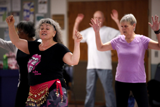 Wanda Serino-Washington, front, leads the Refugee Elder Zumba class Fridays at the Aurora Center for Active Adults. The class began in the summer of 2013 and is not only for refugee elders, but all members of the ACAA. (Photo by Philip B. Poston/Aurora S