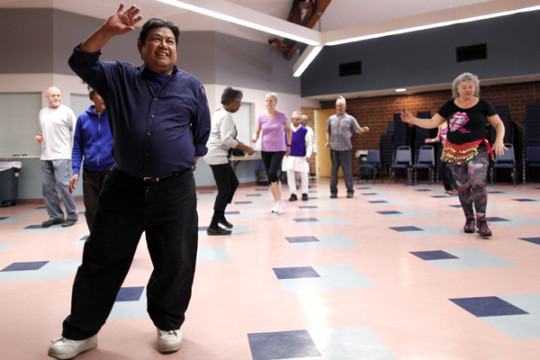 Htoo Hay, left, is a Burmese refugee who is an active paricipant in the Refugee Elder Zumba class at the Aurora Center for Active Adults on Friday afternoons. (Photo by Philip B. Poston/Aurora Sentinel)