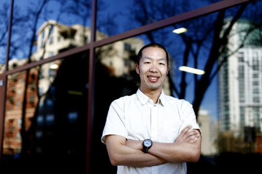 Dr. Gregory Tung takes a brief moment from a meeting to pose for a portrait March 11, in Downtown Denver. Dr. Tung, an assistant professor at the Colorado School of Public Health at CU Anschutz, was recently awarded a$250,000 grant and will be leading the new community Health Impact Assessment, to analyze how a nonprofit hospital like Children's Hospital Colorado can better benefit the community it serves.(Photo by Philip B. Poston/Aurora Sentinel)