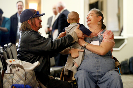 Jeff Kirkland and Norma Armistead spend a moment with their grandchild before the Bridges to Care graduation Feb. 4 at the Summit Conference Center. Armistead graduated from the intensive 60 day training program, which is geared toward individuals who ove