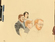 A preliminary artist sketch of James Holmes, with gray jacket and glasses.