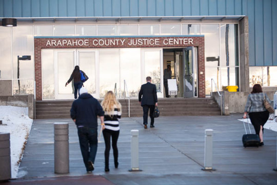 People file into the Arapahoe County Justice Center on Jan. 20. The trial for accused theater shooter James Holmes is expected to begin jury selection, which may stretch on for up to two months. (Marla Keown/Aurora Sentinel)