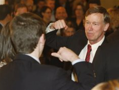 Colorado Gov. John Hickenlooper, right, prepares to bump fists with one of his supporters at election night gathering in Union Station in downtown Denver on Tuesday, Nov. 4, 2014. Hickenlooper, the Democratic incumbent seeking his second, four-year term, told supporters to head home since the race against Republican banker Bob Beauprez was still undecided. (AP Photo/David Zalubowski)