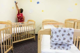 A nursery worker at APS Early Beginnings program gets the school nursery ready for the day. The program for teen mothers works to help young moms get their diploma and avoid the known pitfalls of teen parents. A state program that allows for free birth control could be in jeopardy because of Republican opposition. The program is credited with reducing teen pregnancy and the need for programs like the one in APS.