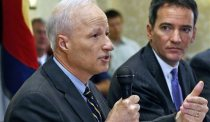 U.S. Rep. Mike Coffman, R-Colo., left, and Democratic challenger Andrew Romanoff face off in their first debate in Highlands Ranch, Colo., Thursday Aug. 14, 2014. The race is expected to be one of the closest in the country. (AP Photo/Brennan Linsley)