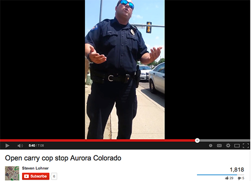 A screen image from a YouTube video posted by an 18-year-old Aurora man. The man was carrying a 12-gauge shotgun on Colfax when contacted by police. He was charged with obstruction when he refused to tell police his name or show them his ID.