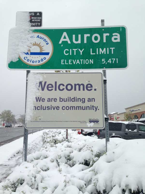 A sign near Aurora's western city limit on East Iliff Avenue is seen May 12. Snow snarled traffic Monday for commuters driving into the city. (Marla Keown/Aurora Sentinel)