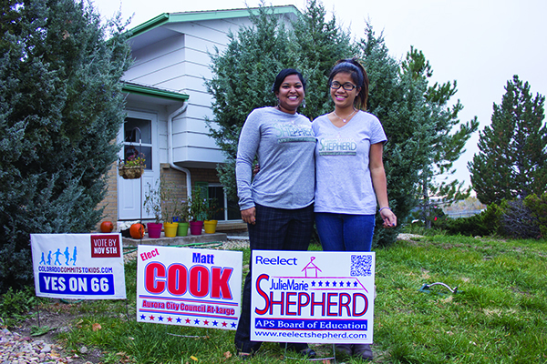 Julie Marie Shepherd (left), school board candidate, and her sister Sarah plant signs in hopes of gathering more votes, Oct. 29 in Aurora. Candidates for this election also include Jasper Armstrong and Amber Drevon.(Danielle Shriver/ Aurora Sentinel)