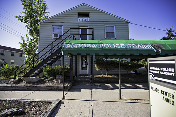 A tattered awning shades an entrance to the Aurora Police Training Academy, Aug. 27 at Fitzsimons.  The city's police and fire staff have been lobbying for a new training center for years, saying their current facilities are rundown and unsafe.  (Marla R. Keown/Aurora Sentinel)