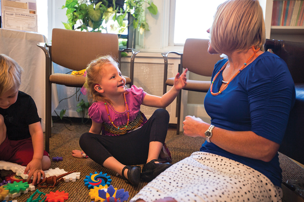 Nyla Morisset, 5, talks with her audiologist doctor Stacy Claycomb at the Marion Downs Hearing Center.  (Marla R. Keown/Aurora Sentinel)