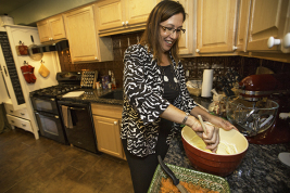 Jenise May prepares lasagna Sept 26 at her home in Aurora. May is the former deputy director of the Colorado Department of Human Services.  (Marla R. Keown/Aurora Sentinel)
