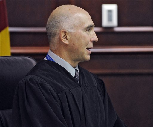 District Court Judge William Blair Sylvester speaks as James E. Holmes appears in Arapahoe County District Court. On Tuesday, Sylvester refused to lift a gag order in the Holmes Aurora theater shooting case, despite days of testimony and revelations during a public hearing in January.)