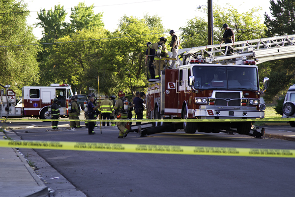 Members of the bomb squad and fire department come down a ladder after assessing shooting suspect James Holmes' apartment Friday morning, July 20, at Paris Street and East 17th Avenue.  Aurora will hire a consultant to analyze police and fire response to the shooting and attempted bombing that killed 12 inside Century 16 Theater and wounded about 70 others.   (Marla R. Keown/Aurora Sentinel)