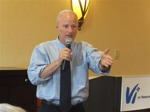6TH DISTRICT Rep. Mike Coffman explains his votes on health care and federal spending to a group of voters at an assisted-living development in Highlands Ranch, Colo., on Tuesday, July 3, 2012.  (AP Photo/Kristen Wyatt)