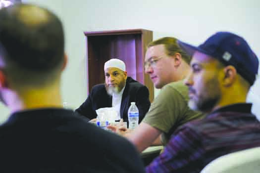 Imam Karim AbuZaid, center left, participates in group discussion at the Colorado Muslim Community Center July 25 in Aurora, CO.Philip B. Poston/Aurora Sentinel