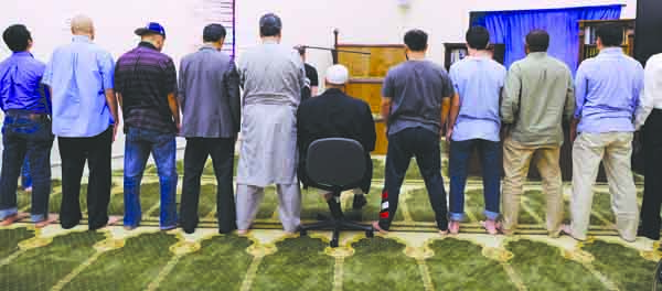 Evening prayer is observed at the Colorado Muslim Community Center, July 25 in Aurora, CO. The CMCC has several prayer rooms for men and women, but also has a gymnasium for activities with children, a gym with weights for exercise and a conference room fo