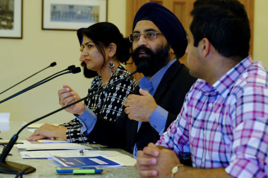 Paul Juneja, center right, addresses a committee of school board members from the 6th Congressional District and Representative Coffman, about the difficulties of being a Sikh child in public schools and the pertinence of education of their religion in th