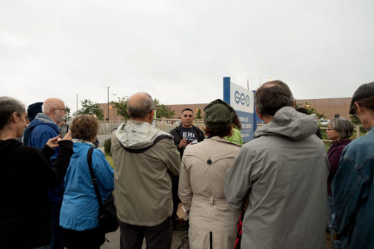 Isidro Quintana, center, addresses a crowd of protestors, Aug. 7 outside the GEO Immigration Detention Center. Quintana, who is a spokesperson for the Deteniton Watch Center, spent over two months in the detention center resulting in the loss of his home