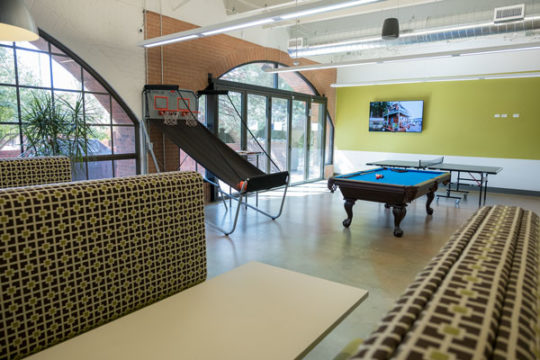 A second break room plays host to an arcade style basketball game, a pool table and ping pong table, as well as a full stocked kitchen. The new larger offices will allow for the growth of up to 600 employees.