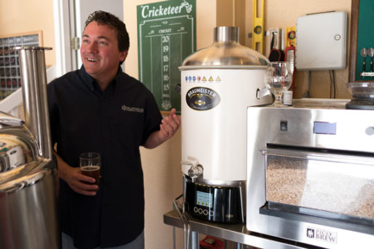 Jean Verrier shows off some of his homebrew equipment in his garage, Aug. 14. Pilothouse Brewing Company is slated to open early 2018.Portrait by Philip B. Poston/Aurora Sentinel