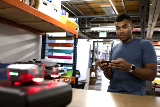Owen Brown, drone flight instructor at Minecraft makerspace, fires up his drone in the shops workspace. Brown has been offering private drone classes for two months and hopes to soon be incorporating larger classes on drone flying into the schedule. Phot