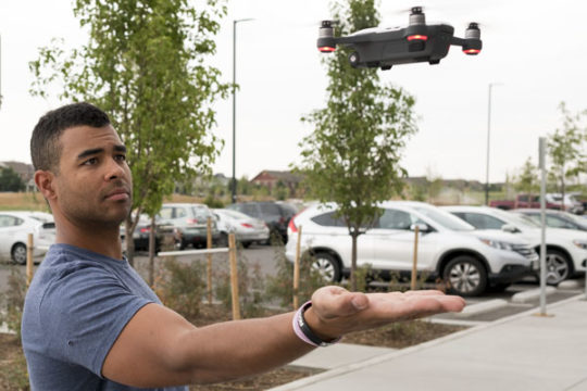Owen Brown, drone flight instructor at Minecraft makerspace, tries to land his drone in the palm of his hand using a special gesture feature. Brown has been offering private drone classes for two months and hopes to soon be incorporating larger classes on
