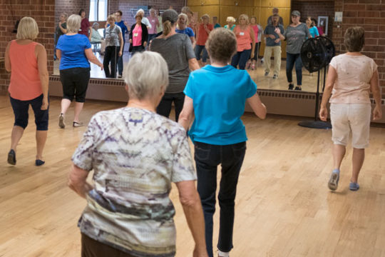 Seniors pull out there best dance moves during the line dancing class Sept. 7 at the Aurora Center for Active Adults. Photo by Philip B. Poston/Aurora Sentinel