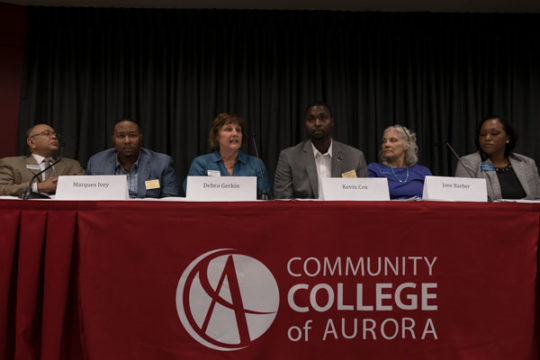 Aurora Public Schools school board candidates introduce themselves to the crowd before fielding questions from those in attendance, Sept. 21 at Community College of Aurora.Photo by Philip B. Poston/Aurora Sentinel