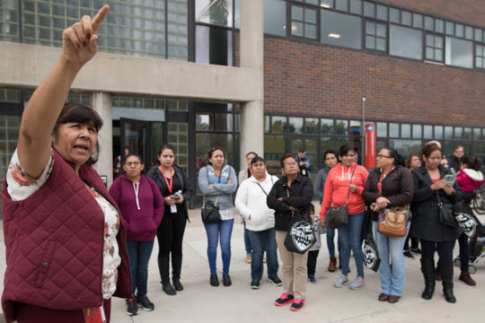 Spanish translator, Emma Lopez, points out the different CU Denver buildings on the Auraria Campus on Sept. 21. The children of these parents will be the first of their families to attend college, should they choose to do so. Photo by Philip B. Poston/Au