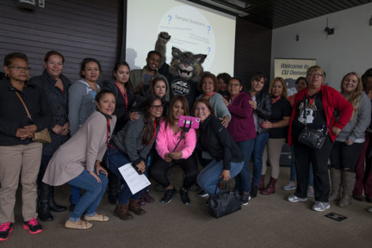 Parents of Elkhart Elementary School students take a selfie with Milo the Lynx, Sept. 25 at CU Denver on Auraria Campus in Denver. The children of these parents will be the first of their families to attend college, should they choose to do so. Photo by
