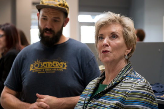 Administrator of the Small Business Administration, Linda McMahon, admires the interior of Rosenberg's Bagels with the locations general manager Michael Lavery, Sept. 28 at the Stanley Marketplace. Photo by Philip B. Poston/Aurora Sentinel