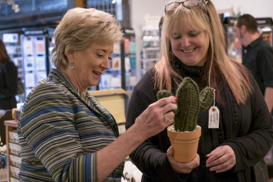 Administrator of the Small Business Administration, Linda McMahon, left, squeezes a felt hand-made cactus with Trunk Noveau co-owner Stephanie Shearer, Sept. 28 at the Stanley Marketplace.