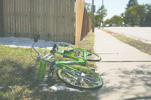 A Lime Bike lays in someone's yard Oct. 10 at the corner of Alaska Ave. and Troy St. The new bike-share service has these lime green and yellow bicycles parked or placed throughout the city, available for use for $1.00 per 30 minutes.Photo by Philip B. P