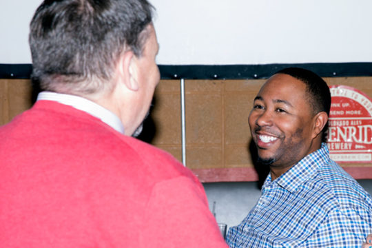 APS School Board Candidate Marques Ivey speaks with Bruce Wilcox, President of the Aurora Education Association, during the APS School Board Election Watch Party Nov. 7 at Legends Sports Bar.
