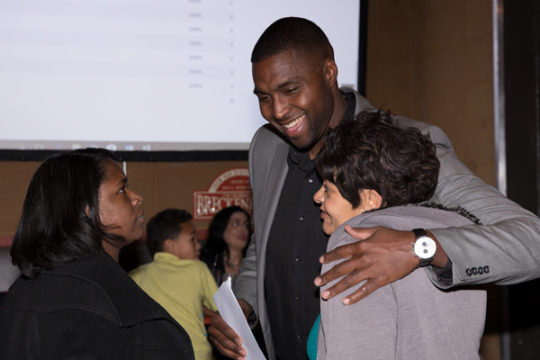 APS School Board Candidate Kevin Cox hugs an attendee of the APS School Board Election Watch Party Nov. 7 at Legends Sports Bar.