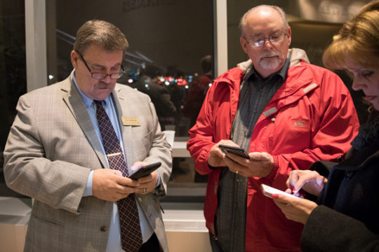 City Council candidate Tim Huffman checks his phone for results during the City Council election watch party, Nov. 7 at the Aurora Municipal Center.