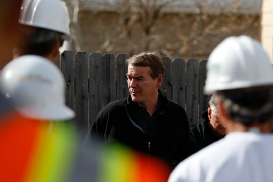 Sen. Michael Bennet, D-CO, is introduced to the team working on the Ortiz-Galvan home, several of which are veterans, Nov. 10 in Aurora, CO. Photo by Philip B. Poston/Aurora Sentinel