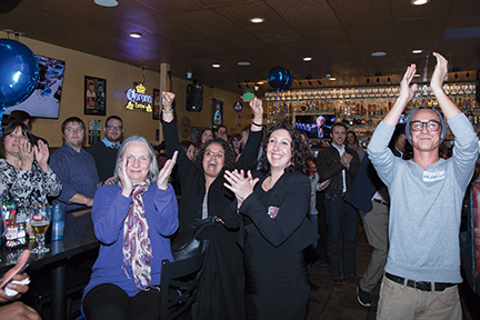 The room erupts as City Council candidate Crystal Murillo enters the Arapahoe COunty Dems watch party at El Tequileno, Nov. 7, after what seems to be likely victory. Photo by Philip B. Poston/Aurora Sentinel