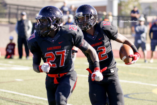 Eaglecrest wide receiver, Victor Garnes, 12, follows his blocker, Kenny Wantings, 27, during the class 5A football semifinal contest, versus Columbine, Nov. 25 at Legacy Stadium. Eaglecrest defeated Columbine in double overtime 32-31 and will face Pamona